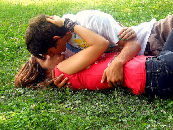 kissing on the grass